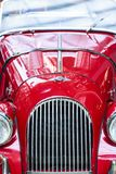 Morgan Grill. A close up view of the front of a cherry red 1963 Morgan +4 vintage automobile Stock Images