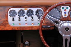 Morgan oldtimer dashboard interior. Car interior of a morgan oldtimer car. Taken on 09-06-2014 during the oldtimer classics in the dutch city deventer Stock Image