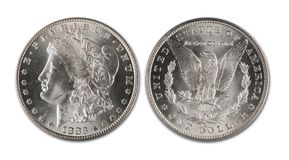 Morgan Silver Dollar. Antique Morgan silver dollar dated 1883 cc showing front and back of coin royalty free stock image