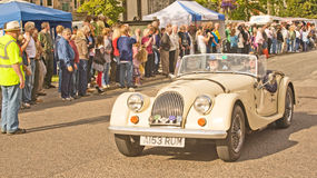 Morgan Sports car at Grantown on Spey. An image of a Morgan Sports car leaving in a parade of classic vehicles the Motormania event held at Grantown on Spey on stock image