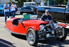 Morgan Three-Wheeler and his Owner. Mr. Steven Kaplan presenting his Morgan three-wheeler that himself built in his Queens garage, at the 2012 Maspeth Antique Royalty Free Stock Image