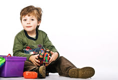 Morgan04. Boy playing with his toys Royalty Free Stock Photos