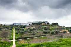 Morgantina settlement under rainy clouds, Sicily Royalty Free Stock Images
