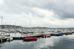 Morgat, France 29 May 2018 Panoramic outdoor view of sete marina Many small boats and yachts aligned in the port. Calm water and b. Lue cloudy sky stock images