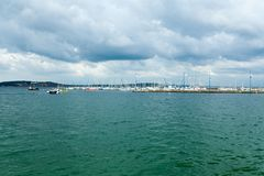 Morgat, France 29 May 2018 Panoramic outdoor view of sete marina Many small boats and yachts aligned in the port. Calm water and b. Lue cloudy sky royalty free stock photo