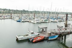 Morgat, France 29 May 2018 Panoramic outdoor view of sete marina Many small boats and yachts aligned in the port. Calm water and b. Lue cloudy sky royalty free stock image