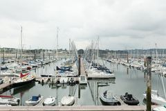 Morgat, France 29 May 2018 Panoramic outdoor view of sete marina Many small boats and yachts aligned in the port. Calm water and b. Lue cloudy sky stock photography