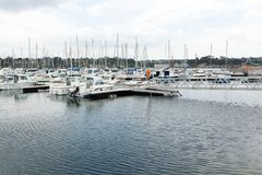 Morgat, France 29 May 2018 Panoramic outdoor view of sete marina. Many small boats and yachts aligned in the port. Calm water and blue cloudy sky stock photo