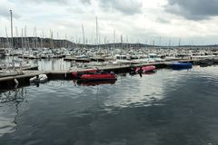 Morgat, France 29 May 2018 Panoramic outdoor view of sete marina Many small boats and yachts aligned in the port. Calm water and b. Lue cloudy sky stock photos