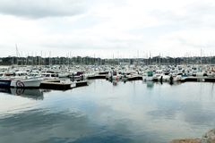 Morgat, France 29 May 2018 Panoramic outdoor view of sete marina Many small boats and yachts aligned in the port. Calm water and b. Lue cloudy sky royalty free stock photos