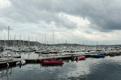 Morgat, France 29 May 2018 Panoramic outdoor view of sete marina Many small boats and yachts aligned in the port. Calm water and. Blue cloudy sky royalty free stock photo