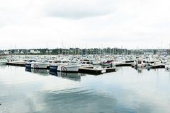 Morgat, France 29 May 2018 Panoramic outdoor view of sete marina Many small boats and yachts aligned in the port. Calm water and. Blue cloudy sky stock images