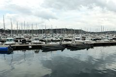 Morgat, France 29 May 2018 Panoramic outdoor view of sete marina. Many small boats and yachts aligned in the port. Calm water and blue cloudy sky royalty free stock photo