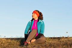 Morgengymnastik der athletischen Frau für Lauf Lizenzfreies Stockfoto