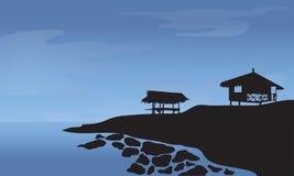 Morgonen med kojan och vaggar på stranden Royaltyfri Bild