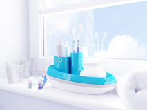 Morgonhygienungar Tandborstar tandkräm, tvål, handduk lokaliseras på en fönsterfönsterbräda Arkivbild
