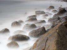 Morgonljus på stoneykusten royaltyfri foto