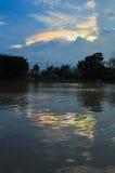 Morgonrodnad ovanför lagun royaltyfria foton
