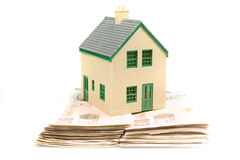 Morgtage. Model house on a pile of ten pound notes Stock Images