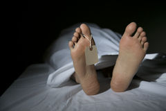 Morgue. A morgue showing the feet of a dead person Stock Photo