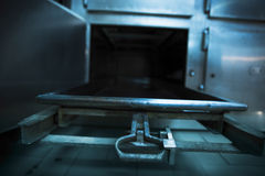 Morgue tray on a grungy morgue. Grungy and high contrast photo of morgue trays Stock Photography