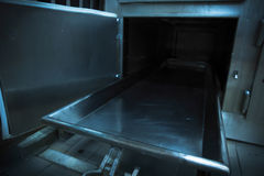 Morgue tray on a grungy morgue. Grungy and high contrast photo of morgue trays Stock Photos