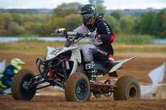 Morgunov Oleg 67. SERPUKHOV, RUSSIA - OCTOBER 7, 2017: Morgunov Oleg 67,  Class ATV, in the 4 stage  MX series, the Red Wings Cup 2017 super country-cross, Moto Royalty Free Stock Photography