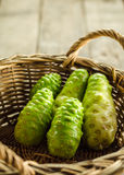 Morinda. In a Basket on a table stock images