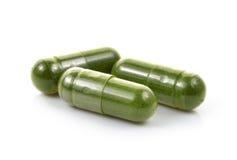 Moringa capsule pills on white background Stock Photo