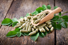Moringa leaves and capsules. Herbs for health Royalty Free Stock Photo