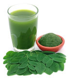 Moringa leaves with extract in a glass Royalty Free Stock Photography