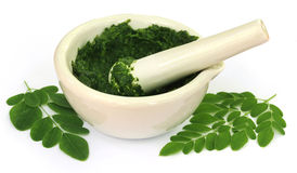 Moringa leaves with mortar and pestle Stock Photo