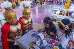 2018 Moriones Festival. BOAC , PHILIPPINES - MARCH 30 : children decorating masks during the Moriones festival in Boac Marinduque island the Philippines. The Royalty Free Stock Images