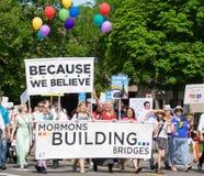 Mormons building bridges at the Salt Lake City Gay Pride Parade. Salt Lake City, Utah, USA - June 7, 2015. Members of the group Mormons Building Bridges march in Stock Photos