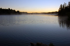 Morning. Sunrise and mist in beautiful lake in Algonquin Park Stock Photos