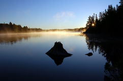 Morning. Sunrise and mist in beautiful lake in Algonquin Park Stock Images