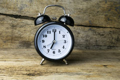 Morning alarm clock on table Stock Photography