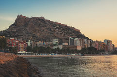 Morning in Alicante, Spain. Beach with Santa Barbara Castle located on Mount Benacantil. Famous Costa Blanca touristic resort, mediterranean sea in Alicante Royalty Free Stock Image