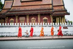 Morning alms offering at Luang Prabang, Laos royalty free stock photo