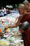 Morning alms-offering to Buddhist monks Stock Images