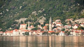 Ancient city, fjord reflection. Kotor bay, Montenegro. The morning ancient Perast city is reflecting on the Kotor bay. Montenegro Royalty Free Stock Photography