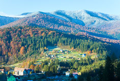 Morning autumn mountain forest and village Royalty Free Stock Images