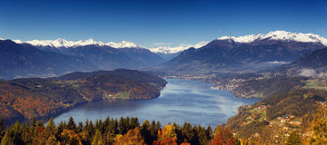 Morning autumn view on Lake Millstatt in Austria. Morning autumn sunny view on Lake Millstatt in Austria, Carinthia. With small towns and villages on shores and Royalty Free Stock Photo