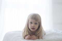 Morning awakening little child girl in bed stock images