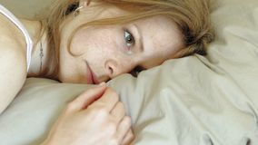 Morning. Awakening women in bed.