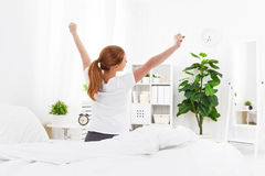Morning awakening of young woman in bed. Morning awakening of a young woman in bed Stock Images