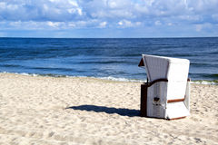 A morning at the Baltic Sea. Empty roofed wicker beach chair at the Usedom beach Stock Images