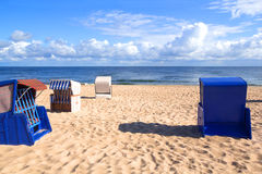 A morning at the Baltic Sea. Empty roofed wicker beach chairs at the Usedom beach Royalty Free Stock Photos