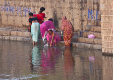 Morning bathing and cleaning on the Betwa River Ghat. Royalty Free Stock Photos