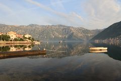 Morning in the Bay of Kotor. Boat and picturesque village Stock Photo